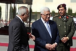 (FILES) This file photo taken on October 14, 2010 shows Palestinian president Mahmoud Abbas and his Prime Minister Salam Fayyad waiting the arrival of visiting Finnish President Tarja Halonen in the West Bank City of  Ramlallah. According to media, a sudden meeting was held between Palestinian President Mahmoud Abbas and former Palestinian Prime Minister Salam Fayyad, before days ago, in the West Bank city of Ramallah. Photo by Issam Rimawi