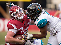 Hawgs Illustrated/BEN GOFF <br /> Cole Kelley, Arkansas quarterback, goes down in the backfield with Marcus Williamson (3), Coastal Carolina defensive end, and Shane Johnson (9), Coastal Carolina linebacker, on the tackle, in the second quarter Saturday, Nov. 4, 2017, at Reynolds Razorback Stadium in Fayetteville.