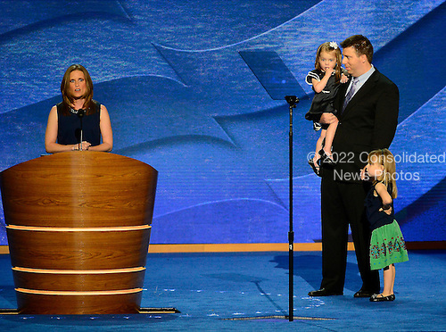 """Stacey Lihn makes remarks in favor of """"Obamacare"""" at the 2012 Democratic National Convention in Charlotte, North Carolina on Tuesday, September 4, 2012.  Her husband and daughters stand at right..Credit: Ron Sachs / CNP.(RESTRICTION: NO New York or New Jersey Newspapers or newspapers within a 75 mile radius of New York City)"""