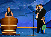 "Stacey Lihn makes remarks in favor of ""Obamacare"" at the 2012 Democratic National Convention in Charlotte, North Carolina on Tuesday, September 4, 2012.  Her husband and daughters stand at right..Credit: Ron Sachs / CNP.(RESTRICTION: NO New York or New Jersey Newspapers or newspapers within a 75 mile radius of New York City)"