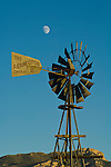 Rusting Aermotor windmill, moon, Egan Range, Lund, Nevada