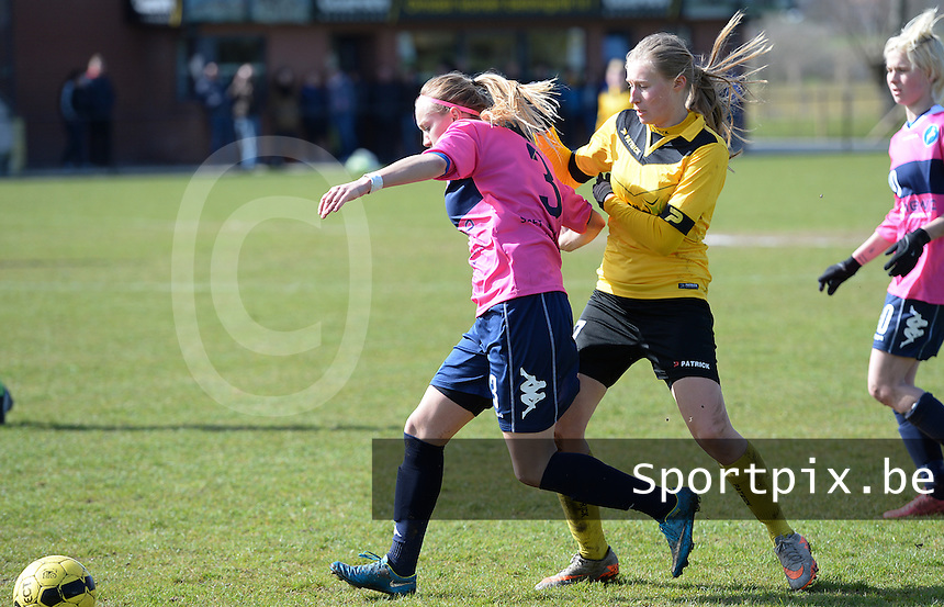 20160328 - Zwevezele , BELGIUM : duel pictured between Turnhout's Sara Blondeel (left) and Zwevezele's Nele Debyser (right)  during the soccer match between the women teams of Voorwaarts Zwevezele and FC Turnhout  , on the 20th matchday of the Belgian Third division for Women on Saturday 28 th March 2016 in Zwevezele .  PHOTO SPORTPIX.BE DAVID CATRY