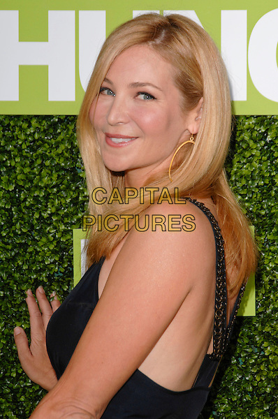 "JENNIFER WESTFELDT.The Premiere Of ""Hung"" held at Paramount Studios, Los Angeles, California, USA. .June 24th, 2009 .half length black blue gold hoop earrings looking over shoulder .CAP/ROT.©Lee Roth/Roth Stock/Capital Pictures"