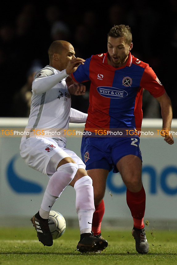 Jake Caprice of Leyton Orient and Michael Cheek of Dagenham during Dagenham & Redbridge vs Leyton Orient, Vanarama National League Football at the Chigwell Construction Stadium on 1st January 2018
