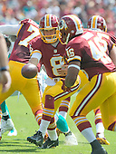 Washington Redskins quarterback Kirk Cousins (8) hands off to running back Alfred Morris (46) in first quarter action against the Miami Dolphins at FedEx Field in Landover, Maryland on September 13, 2015.<br /> Credit: Ron Sachs / CNP