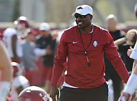 NWA Democrat-Gazette/ANDY SHUPE<br /> Arkansas assistant coach John Scott Jr. speaks to his players Tuesday, March 28, 2017, during spring practice at the UA practice facility in Fayetteville.