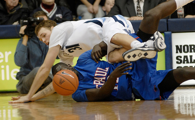 DePaul guard center Mac Koshwal, bottom, scrambles for a loose ball against Villanova guard Taylor King, top, in the first half NCAA college basketball game Wednesday, Jan 6, 2010 in Villanova, Pa. (AP Photo/Bradley C Bower)
