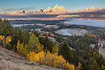 Grand Teton National Park, WY: Morniing light on the Teton Range with fog in the Snake River Valley
