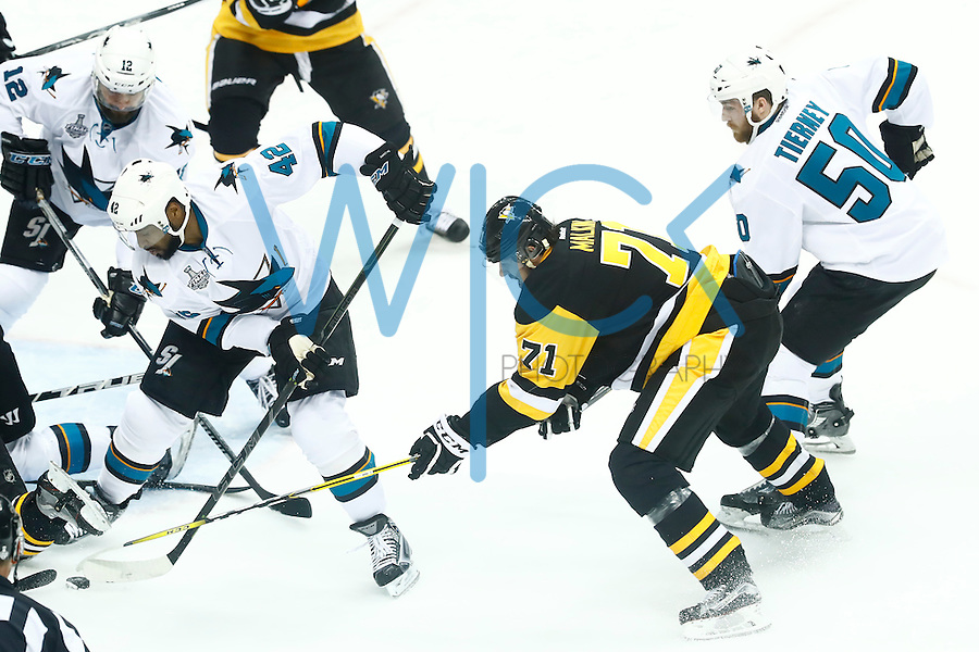 Evgeni Malkin #71 of the Pittsburgh Penguins looks for the loose puck in front of Joel Ward #42 of the San Jose Sharks in the second period during game five of the Stanley Cup Final at Consol Energy Center in Pittsburgh, Pennsylvania on June 9, 2016. (Photo by Jared Wickerham / DKPS)
