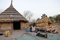 SOUTH-SUDAN Cuibet , Dinka woman infront of her hut in village / SUED SUDAN, Cuibet,  Dinka Frau vor ihrer Huette in einem Dorf