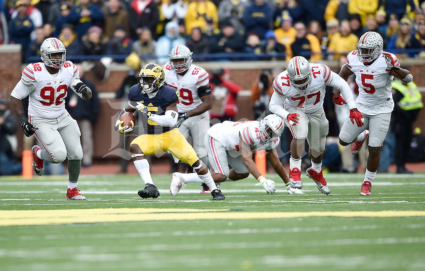 Michigan Wolverines quarterback John O'Korn (5) outruns the Ohio State Buckeyes defense in the second quarter of the college football game between the Michigan Wolverines and the Ohio State Buckeyes at Michigan Stadium in Ann Arbor, Saturday afternoon, November 28, 2015. As of half time the Ohio State Buckeyes led the Michigan Wolverines 14 - 10. (The Columbus Dispatch / Eamon Queeney)
