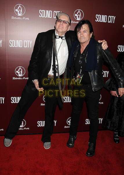 Rick Nielsen, Lee Ving.Attending 'Sound City' Los Angeles Premiere held at the Cinerama Dome, Hollywood, California, USA, .31st January 2013..full length leather jacket suit white shirt trousers arm around .CAP/ADM/BP.©Byron Purvis/AdMedia/Capital Pictures.