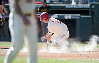 NWA Democrat-Gazette/CHARLIE KAIJO Arkansas Razorbacks infielder Jacob Nesbit (5) scores a run during a baseball game, Sunday, March 17, 2019 at Baum-Walker Stadium in Fayetteville.