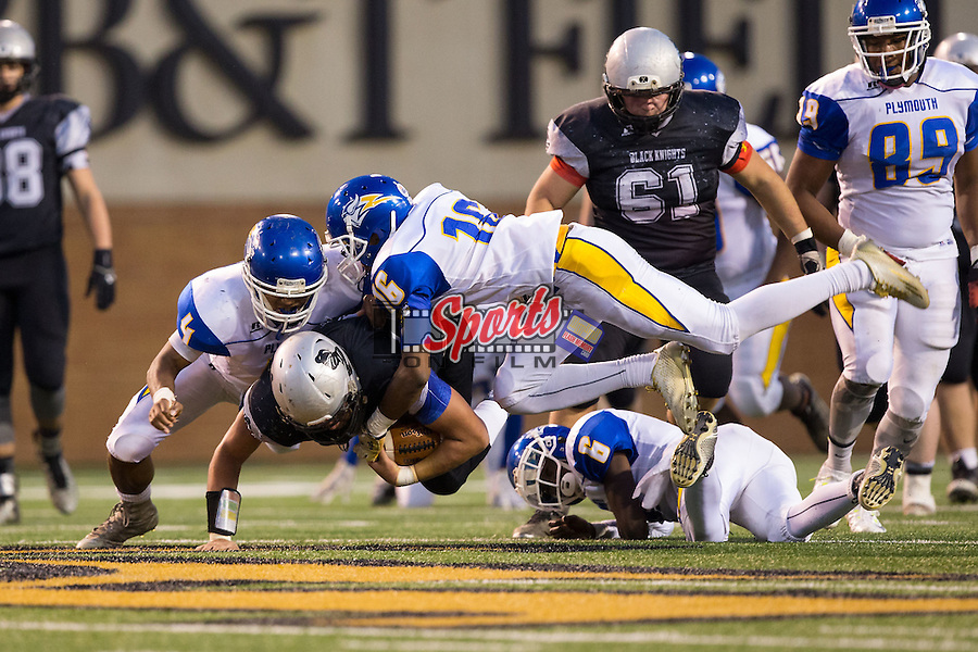 Colby Hemphill (44) of the Robbinsville Black Knights is tackled by Raheem Nixon (4), Jamaze Armstrong (6) and Rickie Young (16) of the Plymouth Vikings during first half action in the NCHSAA 1A State Championship at BB&T Field on December 12, 2015 in Winston-Salem, North Carolina.  The Vikings defeated the Black Knights 28-20.  (Brian Westerholt/Sports On Film)