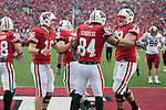 Wisconsin Badgers tight end Lance Kendricks (84) is congratulated by his teammates Ryan Groy (79) and Scott Tolzien (16) after scoring a touchdown during an NCAA college football game against the Indiana Hoosiers on November 13, 2010 at Camp Randall Stadium in Madison, Wisconsin. The Badgers won 83-20. (Photo by David Stluka)