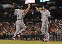 Aug 22, 2007; Phoenix, AZ, USA; Milwaukee Brewers right fielder (18) Gabe Gross is congratulated by third baseman (8) Ryan Braun after scoring on a hit by first baseman (28) Prince Fielder (not pictured) off of Arizona Diamondbacks pitcher (17) Brandon Webb in the first inning at Chase Field. With the run scored it ended a 42 inning scoreless streak by Webb. Mandatory Credit: Mark J. Rebilas-US PRESSWIRE Copyright © 2007 Mark J. Rebilas