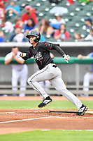 Birmingham Barons second baseman Mitch Roman (7) runs to first base during a game against the Tennessee Smokies at Smokies Stadium on May 15, 2019 in Kodak, Tennessee. The Smokies defeated the Barons 7-3. (Tony Farlow/Four Seam Images)