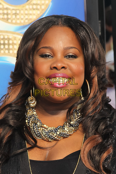 AMBER RILEY.The 20th Century Fox 'Glee 3D' Concert World Movie Premiere held at The Regency Village theatre in Westwood, California, USA,.August 6th 2011..headshot portrait black gold necklace smiling make-up pink earrings sequined sequin .CAP/CEL.©CEL/Capital Pictures