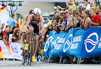 12 JUL 2014 - HAMBURG, GER - Alistair Brownlee (GBR) from Great Britain and England leads the front pack during the bike at the elite men's 2014 ITU World Triathlon Series round in the Altstadt Quarter, Hamburg, Germany (PHOTO COPYRIGHT © 2014 NIGEL FARROW, ALL RIGHTS RESERVED)