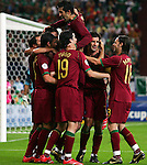 21 June 2006: Simao Sabrosa (POR) (in the middle) is mobbed by teammates after his penalty kick goal in the 21st minute had given Portugal a 2-0 lead. Portugal defeated Mexico 2-1 at Veltins Arena in Gelsenkirchen, Germany in match 31, a Group D first round game, of the 2006 FIFA World Cup.