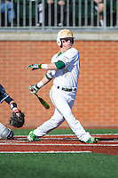 Brett Netzer (9) of the Charlotte 49ers follows through on his swing against the Xavier Musketeers at Hayes Stadium on March 3, 2017 in Charlotte, North Carolina.  The 49ers defeated the Musketeers 2-1.  (Brian Westerholt/Four Seam Images)