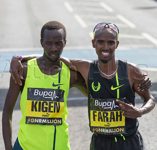 07.09.2014.  South Shields, England.  BUPA Great North Run. Mo Farah (winner of the Great North Run) points to 2nd place Mike Kigen who is also his training partner back in Kenya.