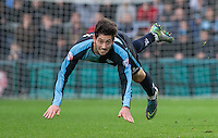 Joe Jacobson of Wycombe Wanderers makes a clearance during the Sky Bet League 2 match between Wycombe Wanderers and Oxford United at Adams Park, High Wycombe, England on 19 December 2015. Photo by Andy Rowland.