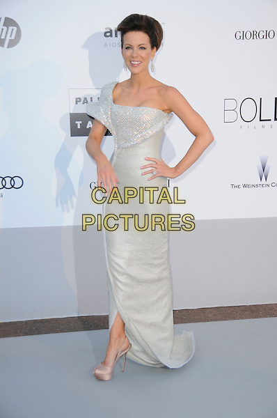 KATE BECKINSALE.arrivals at amfAR's Cinema Against AIDS 2010 benefit gala at the Hotel du Cap, Antibes, Cannes, France during the Cannes Film Festival.20th May 2010.amfAR full length long maxi dress one shoulder white silver diamante shiny sparkly sculpted  hair up hand on hip beige silk satin peep toe platform shoes .CAP/CAS.©Bob Cass/Capital Pictures.