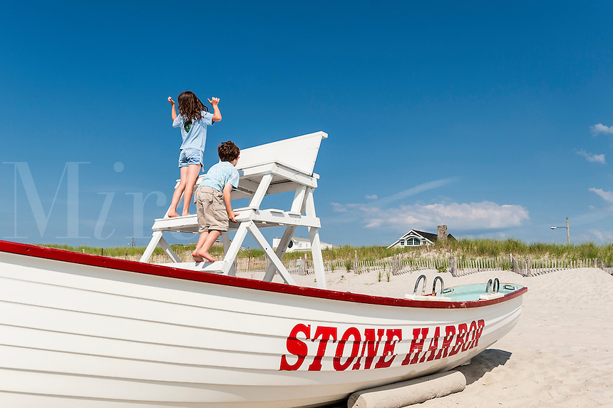 Kids climbing the lifesguard stand, Stone Harbor, New Jersey, USA