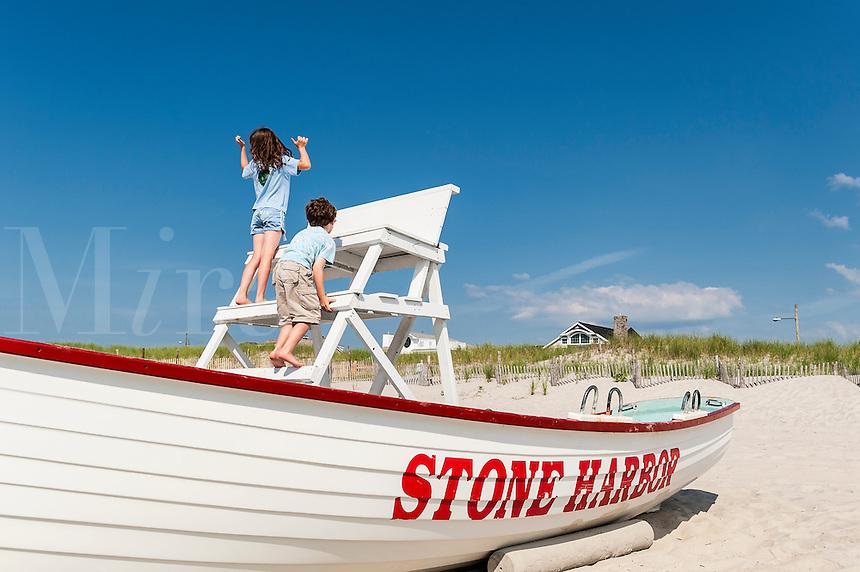 Kids climbing the lifesguard stand, Stone Harbor, New Jersey, USA
