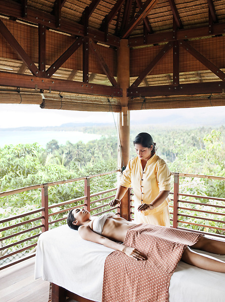 A woman receives reiki, an energy healing treatment, at the spa at Kamalaya resort. Koh Samui, Thailand.