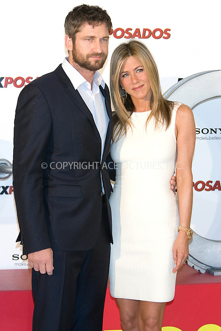 WWW.ACEPIXS.COM . . . . .  ..... . . . . US SALES ONLY . . . . .....March 30 2010, Madrid....Actors Gerald Butler and Jennifer Aniston at a photocall for 'Exposados' (The Bounty Hunter) at the Villamagna Hotel on March 30, 2010 in Madrid, Spain.......Please byline: FD-ACE PICTURES... . . . .  ....Ace Pictures, Inc:  ..tel: (212) 243 8787 or (646) 769 0430..e-mail: info@acepixs.com..web: http://www.acepixs.com