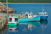 Fishing boats in coastal village. Cabot Trail. Cape Breton Island. <br />Neils Harbour<br />Nova Scotia<br />Canada