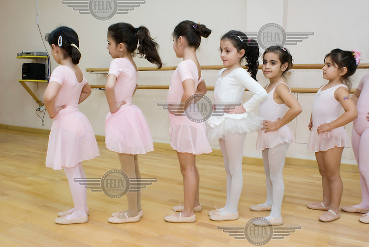 Girls aged between four and six attend their first ballet class at the National Centre for Culture and Performing Arts (PAC) in Amman. The Dance School at the Centre was established in 1997 (PAC was founded in 1987 under the umbrella of the King Hussein Foundation), and for a long time it was the only dance school of its kind in Jordan. Since 1996 about 4,620 girls and three boys have attended the ballet classes..