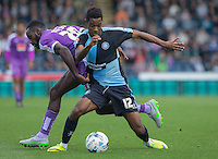 Jason Banton of Wycombe Wanderers battles with Hiram Boateng of Plymouth Argyle during the Sky Bet League 2 match between Wycombe Wanderers and Plymouth Argyle at Adams Park, High Wycombe, England on 12 September 2015. Photo by Andy Rowland.