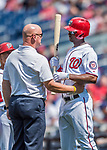 16 August 2017: Washington Nationals outfielder Michael Taylor has a discussion with Director of Athletic Training Paul Lessard after a foul hits his face during a game against the Los Angeles Angels at Nationals Park in Washington, DC. The Angels defeated the Nationals 3-2 to split their 2-game series. Mandatory Credit: Ed Wolfstein Photo *** RAW (NEF) Image File Available ***