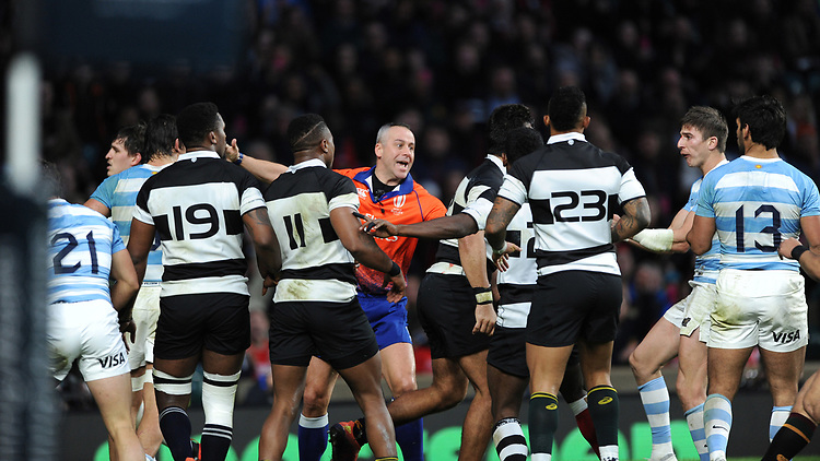 Referee John Lacey of Ireland gets involved in a scuffle after a try during the Killik Cup match between the Barbarians and Argentina at Twickenham Stadium on Saturday 1st December 2018 (Photo by Rob Munro/Stewart Communications)