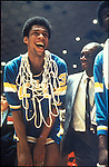 "22 MAR 1969:  UCLA's Lew Alcindor (33) """"Kareem Abdual-Jabbar"""" accepts congratulations form his father after winning the Men's Final Four championship held in Louisville, KY at Freedom Hall. UCLA defeated Purdue 92-72 to win the title. Photo Coopyright Rich Clarkson"