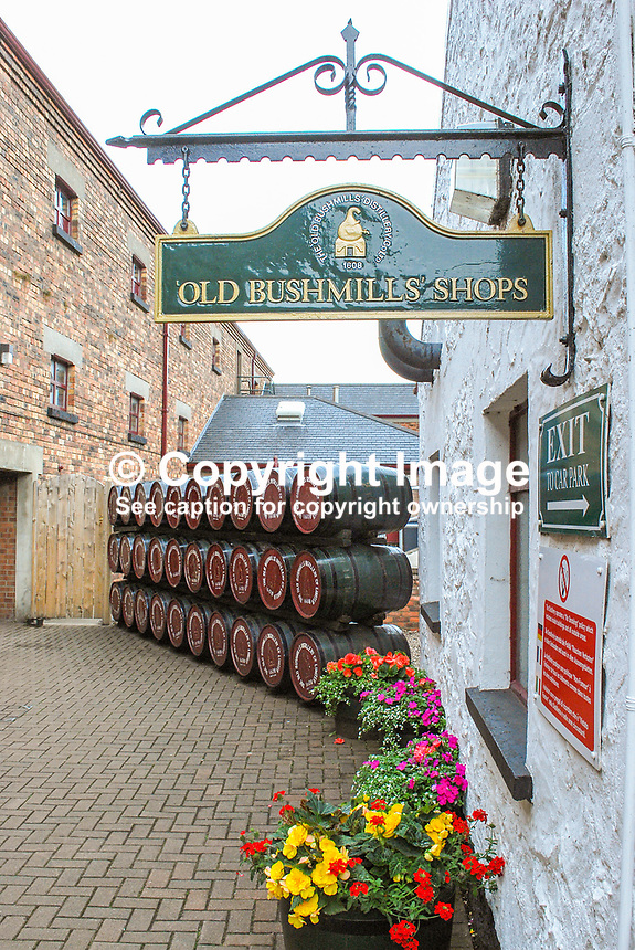 Old Bushmills Distillery Co Ltd, shop, flowers, paving, premises, Bushmills, Co Antrim, N Ireland, 200808020489, signage..Copyright Image from Victor Patterson, 54 Dorchester Park, Belfast, UK, BT9 6RJ..Tel: +44 28 9066 1296.Mob: +44 7802 353836.Voicemail +44 20 8816 7153.Skype: victorpattersonbelfast.Email: victorpatterson@mac.com.Email: victorpatterson@ireland.com (back-up)..IMPORTANT: If you wish to use this image or any other of my images please go to www.victorpatterson.com and click on the Terms & Conditions. Then contact me by email or phone with the reference number(s) of the image(s) concerned.