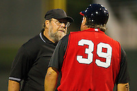 Home plate umpire Mike Watkins listens as Kannapolis Intimidators manager Tommy Thompson #39 argues a call during the South Atlantic League game against the Lakewood BlueClaws at Fieldcrest Cannon Stadium on July 16, 2011 in Kannapolis, North Carolina.  The Intimidators defeated the BlueClaws 5-3.   (Brian Westerholt / Four Seam Images)