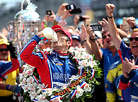 May 28, 2017; Indianapolis, IN, USA; IndyCar Series driver Takuma Sato drinks milk as he celebrates after winning the 101st Running of the Indianapolis 500 at Indianapolis Motor Speedway. Mandatory Credit: Mark J. Rebilas-USA TODAY Sports