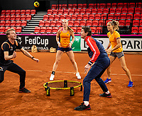 The Hague, The Netherlands, Februari 4, 2020,  Sportcampus , FedCup  Netherlands - Balarus, Dutch team practise, playing spike ball, ltr: coach Roel Oostdam, Kiki Bertens, Captain Paul Haarhuis, and Arantxa Rus.<br /> Photo: Tennisimages/Henk Koster