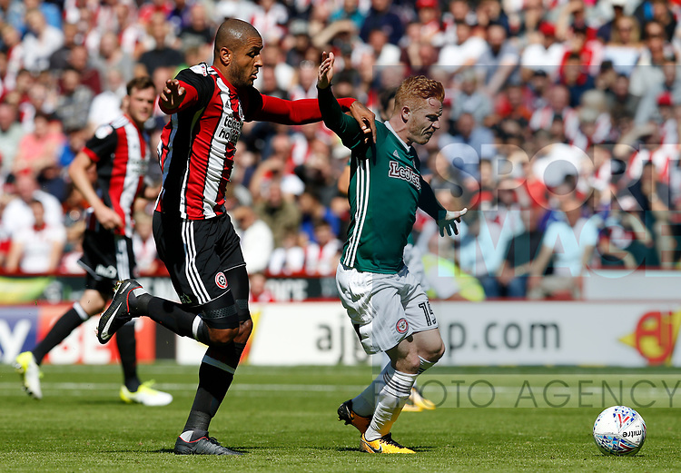 Leon Clarke of Sheffield Utd tussles with Ryan Woods of Brentford during the English Championship League match at Bramall Lane Stadium, Sheffield. Picture date: August 5th 2017. Pic credit should read: Simon Bellis/Sportimage