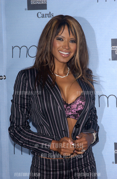 Actress TRACI BINGHAM at the 22nd Annual Macy's and American Express Passport '04 - America's premiere HIV/AIDS findraiser & fashion show - at the Santa Monica Airport..September 30, 2004