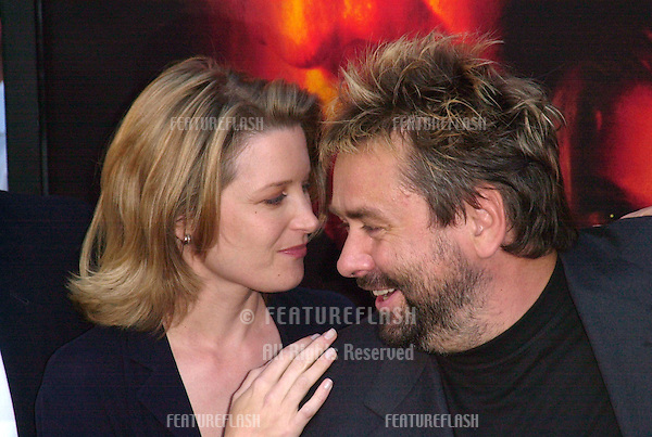 Producer/screenwriter LUC BESSON & actress BRIDGET FONDA at the Los Angeles premiere of their new movie Kiss of the Dragon..25JUN2001.  © Paul Smith/Featureflash