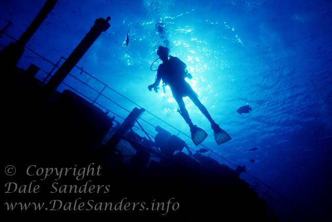 Silhouette of a Scuba Diver on the Wreck of the Oro Verde in the 1980's, Grand Cayman Island, BWI.