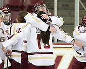 Taylor Wasylk (BC - 9), Danielle Doherty (BC - 19) - The Boston College Eagles celebrate winning the 2014 Beanpot championship on Tuesday, February 11, 2014, at Kelley Rink in Conte Forum in Chestnut Hill, Massachusetts.