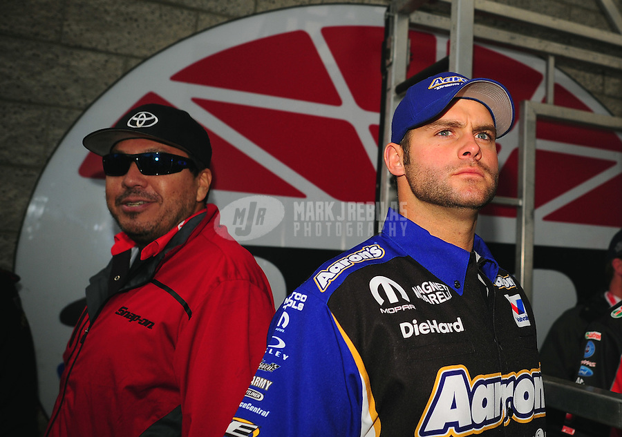 Apr. 1, 2012; Las Vegas, NV, USA: NHRA funny car driver Matt Hagan (right) and Cruz Pedregon during the Summitracing.com Nationals at The Strip in Las Vegas. Mandatory Credit: Mark J. Rebilas-