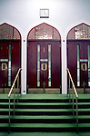 The entrance of the men prayer room of the East London Mosque, one of the biggest and oldest mosque in London..The opening of the East London Mosque was in 1941, which remains one of Londonís oldest and most active community institutions. Until the last two or three decades, many ìmosquesî were confined to small buildings and were in reality only prayer-rooms. However, the community now enjoys spacious, new buildings with some very good facilities for both men and women, and mosques are being built all the time.