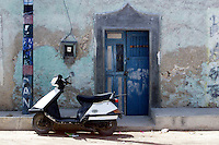 Street scene with motorscooter and chipping paint in Merida, Yucatan Peninsula, Mexico.